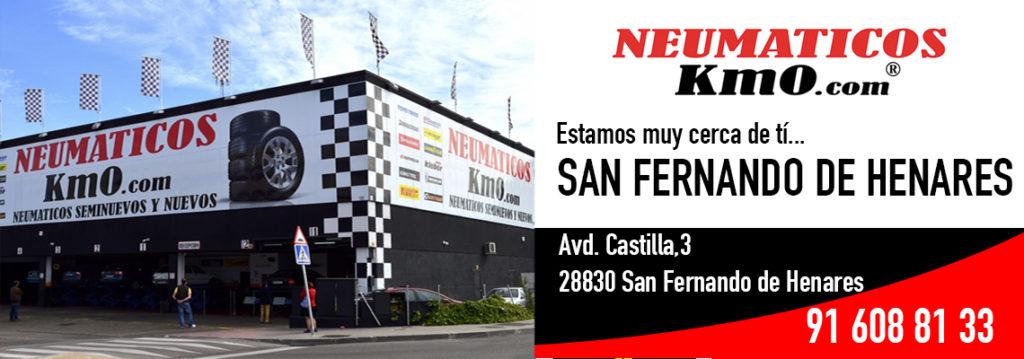 Publicidad taller neumáticos km0 exterior de taller San Fernando de Henares y datos contacto