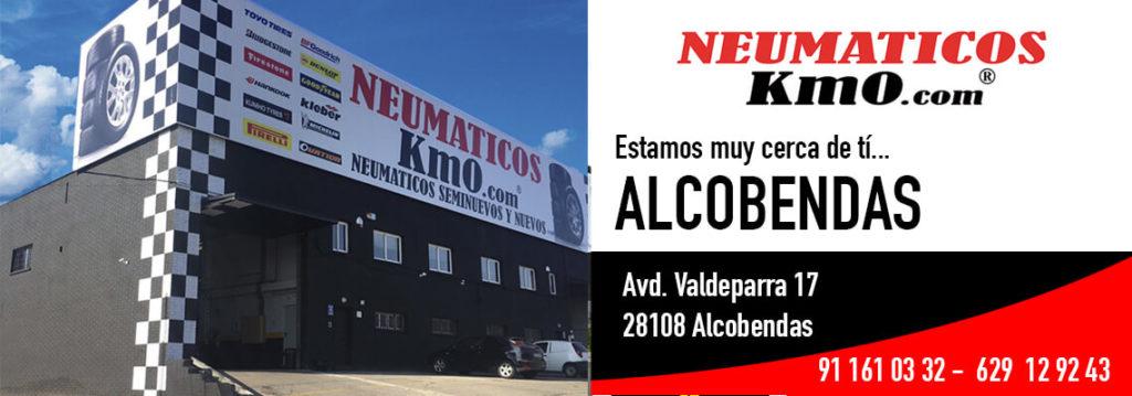 Publicidad taller neumáticos km0 exterior de taller alcobendas y datos contacto