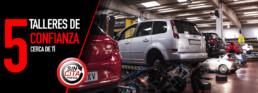 Fotografía interior de taller con varios automóviles. 5 talleres de confianza cerca de ti. Sin cita previa.