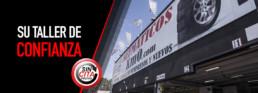 Fotografía exterior de taller de neumáticos km0 y texto: su taller de confianza. Sin cita previa