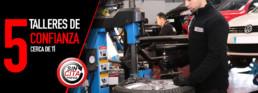 Imagen de un operario trabajando en un neumático. 5 talleres de confianza cerca de ti. Sin cita previa